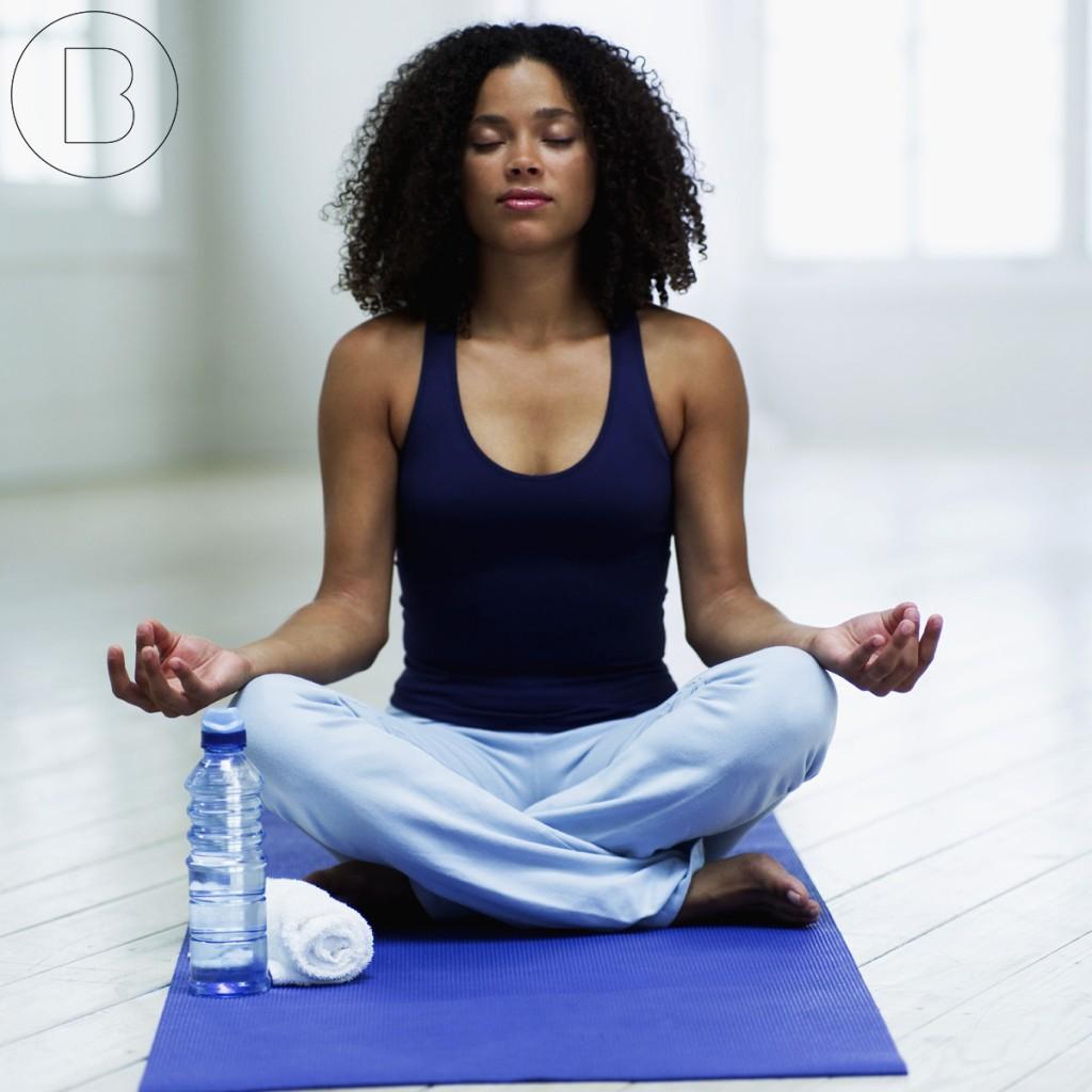 Woman meditating to avoid dental phobia